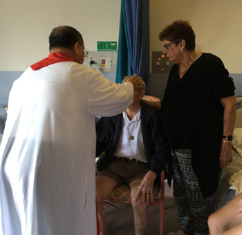 Fr Ronaldo with hospital patient 350